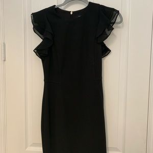 dress with ruffles , goes roughly right above knee